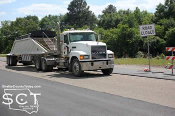 Another truck-tractor is seen stopped at the road closed sign by the intersection of FM 699 at the crash scene.