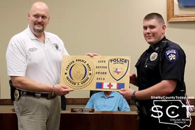 Center Police Chief (left) presents Center Police officer Jake Gross (right) with the Life Saving Award.