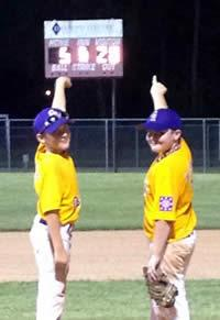 Photo of two players, Garrett Mettauer and Jordan McSwain pointing at the score board 5-20 after the Splendora vs Center game.