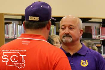 Barry Bowman (right), Center ISD Athletic Director and Head Coach, is seen speaking with Jason Mitchell (left) during the meet and greet event Thursday, July 16, 2015.