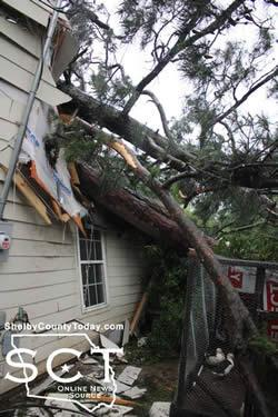 Thankfully one couple was awake when the storm rolled through Center on the 11th of May and ran for safety as a large tree fell into the house they were renting on Houston Street during the early morning hours.