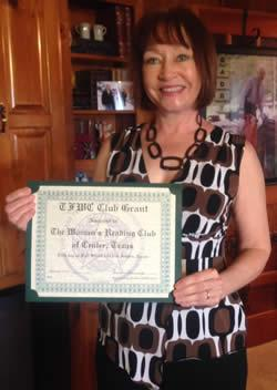 Janene Walker, President, holding the certificate for the Grant received from the Texas Federation of Women in the amount of $200