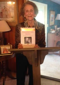 Mrs. Watson holding her book