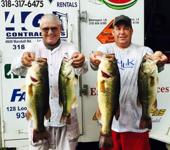 August 24, 2015 - John Olive(left) and Jason Wells(right) show off 4 of their five bass winning stringer.