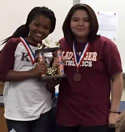 Kamari Gray and Kelly Sandoval proudly showing off the team trophy!