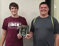 Blayne Cummings (left) and Jacob Samford (right) proudly display their third place plaque from the High School Region VII Robotics Competition.