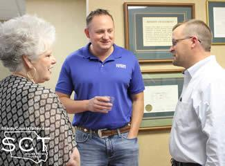 Warren visits with Tim Hopkins, new Branch Manager, and Will Lucas with Shelby Savings Bank who congratulates her on retirement.