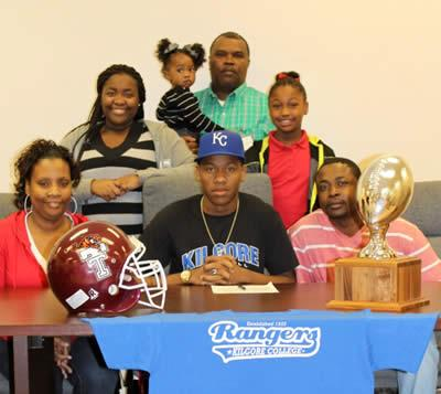 D'Andre Thomas (center) along with his parents Janella Thomas, left front row, and Willie Garner, right front row; sisters Destiny Garner, center row left, D'Chelle Garner, center row right, and sister D'Lashia Garner, back row, along with cousin, Aubrey McClure.