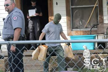 Officers were seen removing evidence bags from the house located on McLaughlin Street
