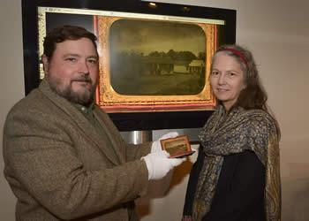 December 15, 2015 - Michael Rugeley Moore, left, recently donated the ambrotype of the stone house to the Stone Fort Museum. Stone Fort Museum Director Carolyn Spears, right, said the image will be on display at the museum as part of the tricentennial celebration in 2016.