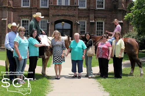 Pictured are (from left: Sheriff Willis Blackwell; Debra Pate Smith, Timpson Mayor; Leigh Porterfield, Shelby County Chamber of Commerce representative; Danny Dixon and his horse Pepper; Allison Harbison, Shelby County Judge; Marilyn Corder, Timpson Area Chamber of Commerce; Rose Dixon; Meg Camp, Dennise Meek and Sarah Dixon astride her horse Floyd.