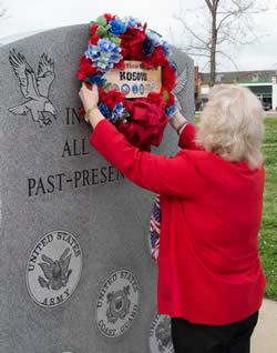 VFW Auxiliary Sr. Vice Sandy Risinger places the memorial wreath.