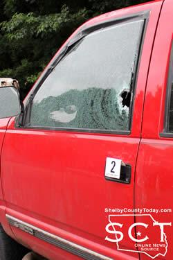 The driver's side window were the shotgun shell entered the vehicle.