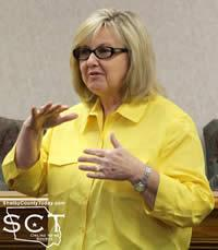 Anne Blackwell, Shelby County Treasurer, is seen describing the need for a dividing wall in her office.