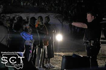 Center Police Officer Jim Blackwell is seen addressing participants in the gathering on Mildred Street Friday night. He could be heard explaining to everyone the dangers of crack cocaine, marijuana and phencyclidine (PCP).