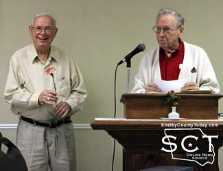 (Right) Bro. Carl Smith installs new officers including Joe Anderson (left) as President.