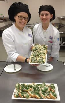 From left, are Stephen F. Austin State University freshman Mallory Jurena, who is majoring in hospitality administration with a focus in restaurant management, and freshman food, nutrition and dietetics major Hollin Jordan prepared a mozzarella pesto bruschetta with ingredients from Appleby Community Farm in Nacogdoches. This meal was part of a new farm-to-table lab created by Dr. Mary Olle, human sciences professor at SFA.