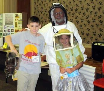 Joshua Woods, a 5th grader at Hemphill and Kahlen Morton, a 3rd grader at Hemphill helped to demonstrate the various equipment in Beekeeping.