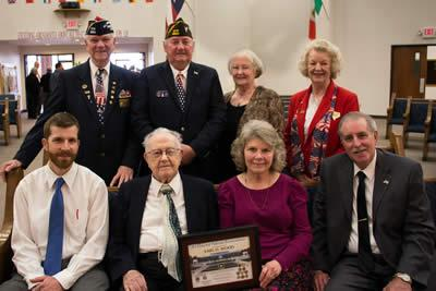 Photo front row (from left), Mr. Woods's grandson Clifford Grimes, Mr. Wood, his daughter Debbie Grimes and son-in-law Eddie Grimes. Back row l-r, Post Quartermaster Larry Hume, Post Chaplain Gene Hutto, Auxiliary Chaplain Mary Fausett and Auxiliary Sr. Vice Sandy Risinger.
