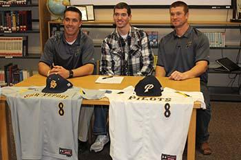Jacob Mitchell (middle) is seen at his letter of intent signing with Coach Al Cantwell (left) and Assistant Coach Brent Lavallee (right).