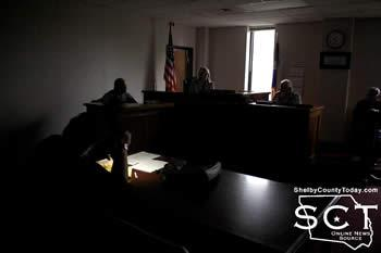 Shelby County Judge Allison Harbison (pictured middle) presided over a darkened courtroom on Monday, May 11, 2015. Jennifer Fountain (foreground left), Shelby County Clerk, is seen taking notes by cell phone light.