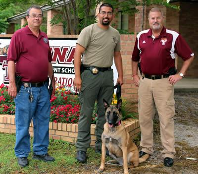 Pictured is Shelby County Constable, Bryan Gray, Panola County K9 deputy Richard Mojica and his K9 Roxie, and Tenaha ISD Police Chief David Jeter.