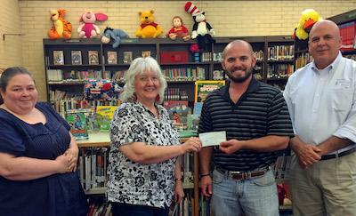 Fannie Brown Booth Memorial Library Director, Sandra Davis accepts a donation from Wil Blackshear, President Center Noon Lions Club for the 2016 Summer Reading Program.  From left to right, Cassey Fowler – Assistant Librarian, Sandra Davis, Wil Blackshear  and Jim Sawyer – Treasurer Center Noon Lions Club.