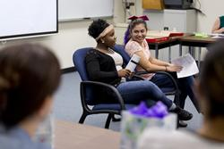 Alexis Willis, left, and Victoria Pentecost speak to their PSY153: Human Sexuality class after completing their service learning projects in December. The course will continue the partnership with the Janelle Grum Family Crisis Center of East Texas in the fall semester.